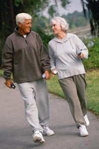 Generic older couple taking exercise.