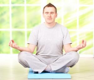 Man doing yoga exercise on mat